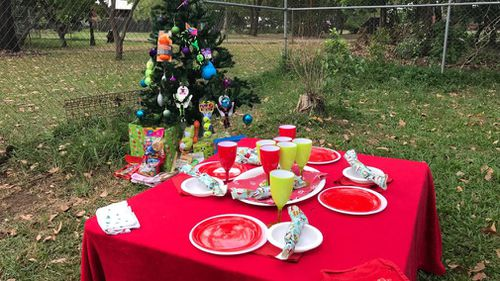 "9NEWS was invited to attend the shelter's ""Christmas Lunch"" event, complete with yummy pet treats, a tree and even presents. (9NEWS/Melissa Mackay)"