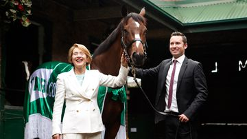 "Horse trainers Gai Waterhouse and Adrian Bott pose with ""English"". (AAP)"