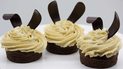 Peanut buttercream frosted cupcakes with bunny ears