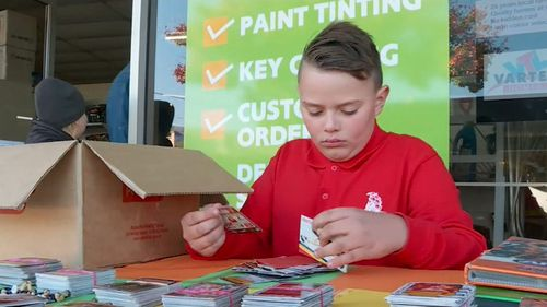 Kyen Jenkins is selling his treasured football cards for a good cause. (9NEWS)