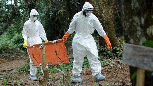 Members of a volunteer medical team wear special uniforms for the burial of 7 people, sterilized after dying due to the Ebola virus, in Kptema graveyard in Kenema, Sierra Leone on August 26, 2014. In recent months, Ebola a contagious disease for which there is no known treatment or cure has claimed at least 1429 lives in West Africa, mostly in Sierra Leone, Guinea and Liberia. (Photo by Mohammed Elshamy/Anadolu Agency/Gett Images)