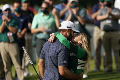 Dustin Johnson is hugged by Pauline Gretzky after winning the Masters golf tournament Sunday, Nov. 15, 2020, in Augusta, Ga. (AP Photo/David J. Phillip)