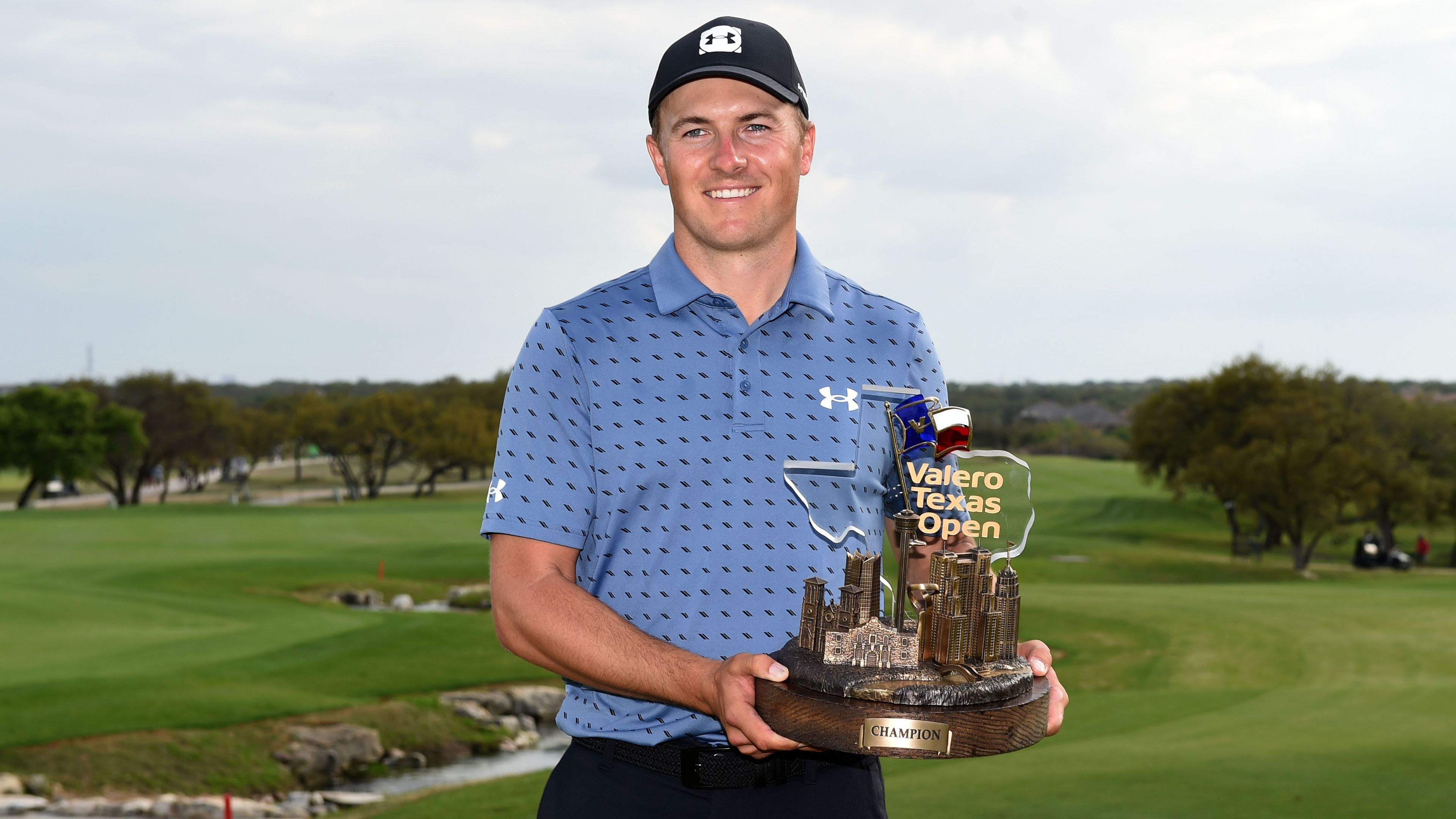Jordan Spieth poses with the trophy after winning the Texas Open.