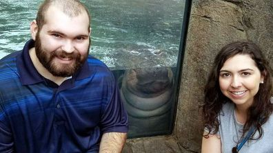 Fiona the Hippo happily photo bombed the couple's special moment.