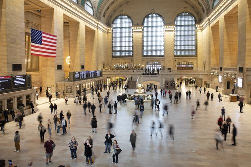 Commuters pass through a quiet Grand Central Terminal, Tuesday, March 10, 2020 in New York.