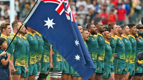 Australian players line up for the national anthem