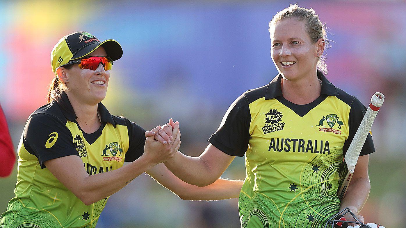 Meg Lanning of Australia celebrates with Megan Schutt