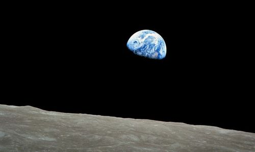 A handout picture released by NASA on 25 December 2013 shows a view of planet Earth seen from the Moon, at space, 24 December 1968.  (AAP)