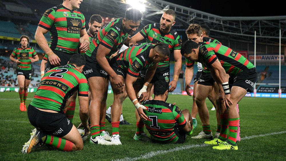 Alex Johnson was injured scoring his third try for the Rabbitohs. (AAP)