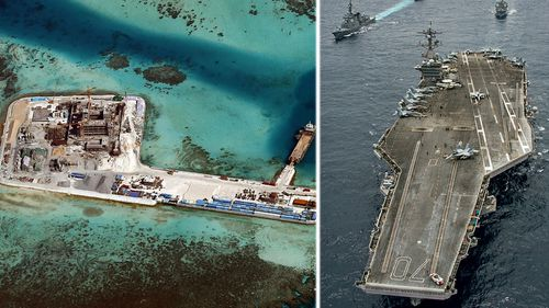 The USS Carl Vinson strike group is expected to sail close to disputed artificial reefs built by China. (AP).