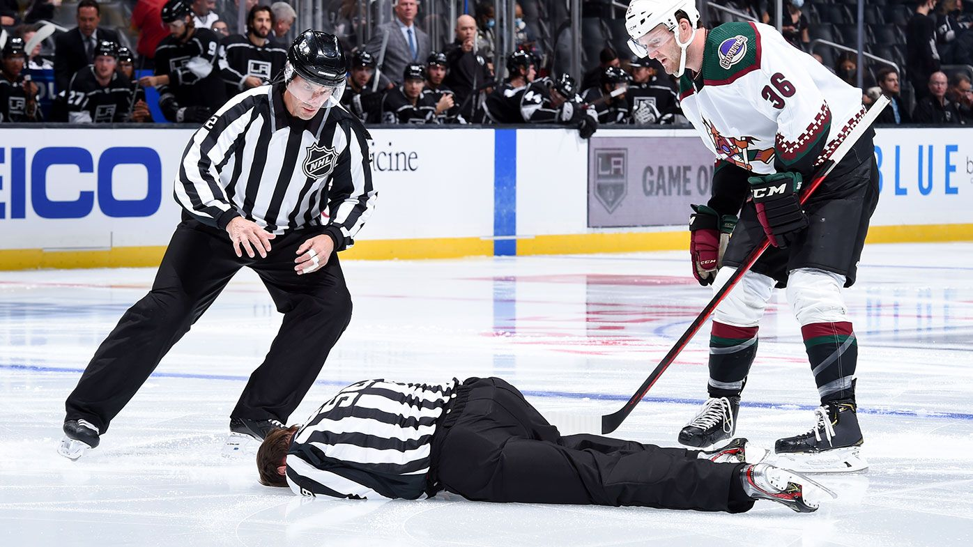 LOS ANGELES, CA - OCTOBER 5: NHL Linesman Ryan Gibbons is tended to after an injury prior to the first period between Los Angeles Kings and Arizona Coyotes at STAPLES Center on October 5, 2021 in Los Angeles, California. (Photo by Juan Ocampo/NHLI via Getty Images)