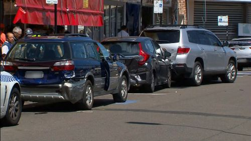 The woman's Subaru also allegedly struck parked cars. (9NEWS)