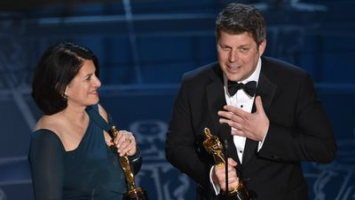 <b>Best Production Design:</b><br><br>Anna Pinnock and Adam Stockhausen accept their Oscars for their work on 'The Grand Budapest Hotel'. (AAP)