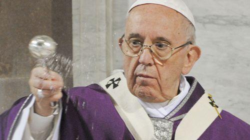 Pope opens launderette for the homeless