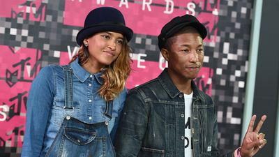 Helen Lasichanh and husband Pharrell Williams rocked the double denim on the VMAs red carpet. (AAP)
