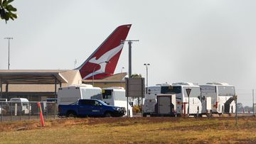 Passengers on a Qantas flight from India are transported to the Howard Springs quarantine facility in Darwin, Australia.
