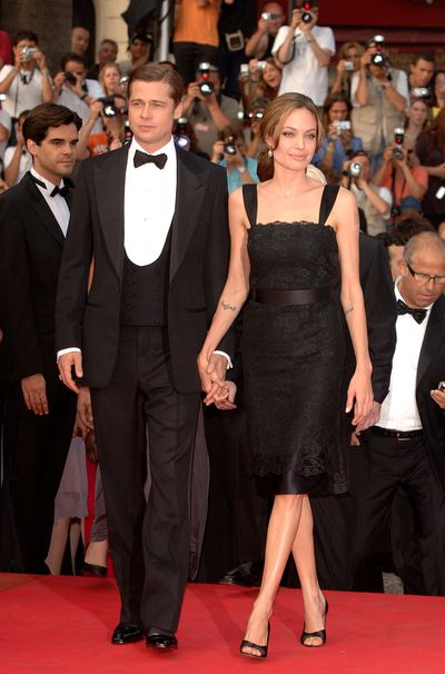 Angelina Jolie in Dolce &amp; Gabbana and Brad Pitt at the premiere of <em>A Mighty Heart</em> in Cannes in May, 2007
