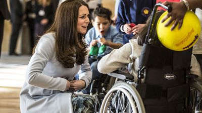 The Duchess of Cambridge reveals to Martina McDonagh she can feel her baby kicking as she opens the Kensington Leisure Centre. (AAP)