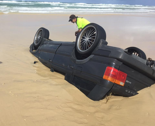 Incredibly, none of the car's occupants were injured when it rolled. (Queensland Ambulance Service)