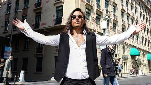 Salt Bae poses in front of his new hotel, the Park Hyatt Hotel Istabul
