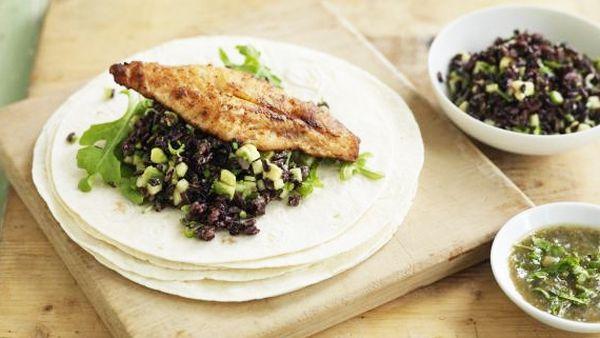 Fish tortilla with avocado rice and rocket