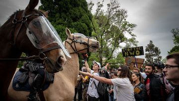 Protesters and members of Victoria Police clash on October 23, 2020 in Melbourne, Australia.