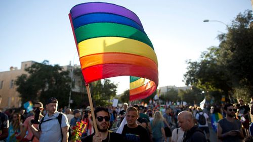 The iconic eigh-coloured banner made its premiere on San Francisco's gay pride freedom day in 1978. (Getty Images)