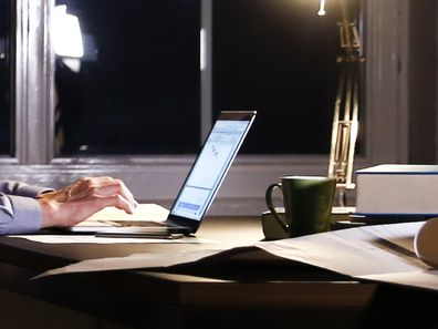 Man using computer in office at night