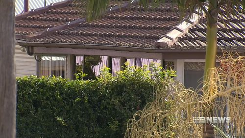 A woman known to Mr Gordon suffered facial injuries at a Carina Heights home. (9NEWS)