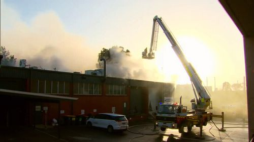 Thick smoke billowed from the building as it burned this morning. (9NEWS)