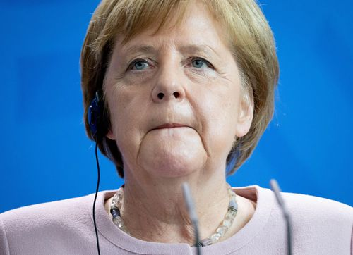 Angela Merkel has blamed dehydration for her recent trembling during a ceremony for the new Ukrainian president.