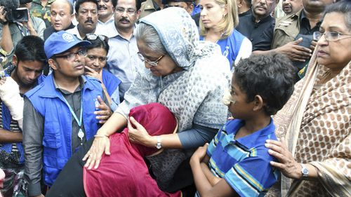 Bangladeshi Prime Minister Sheikh Hasina, center, meets with Rohingya Muslims at Kutupalong refugee camp, near the border town of Ukhia, Bangladesh on Tuesday. (AAP)