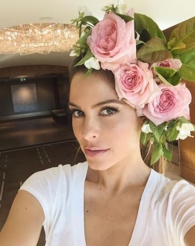 E News! anchor Maria Menounos in a crown crafted by her hairstylist.