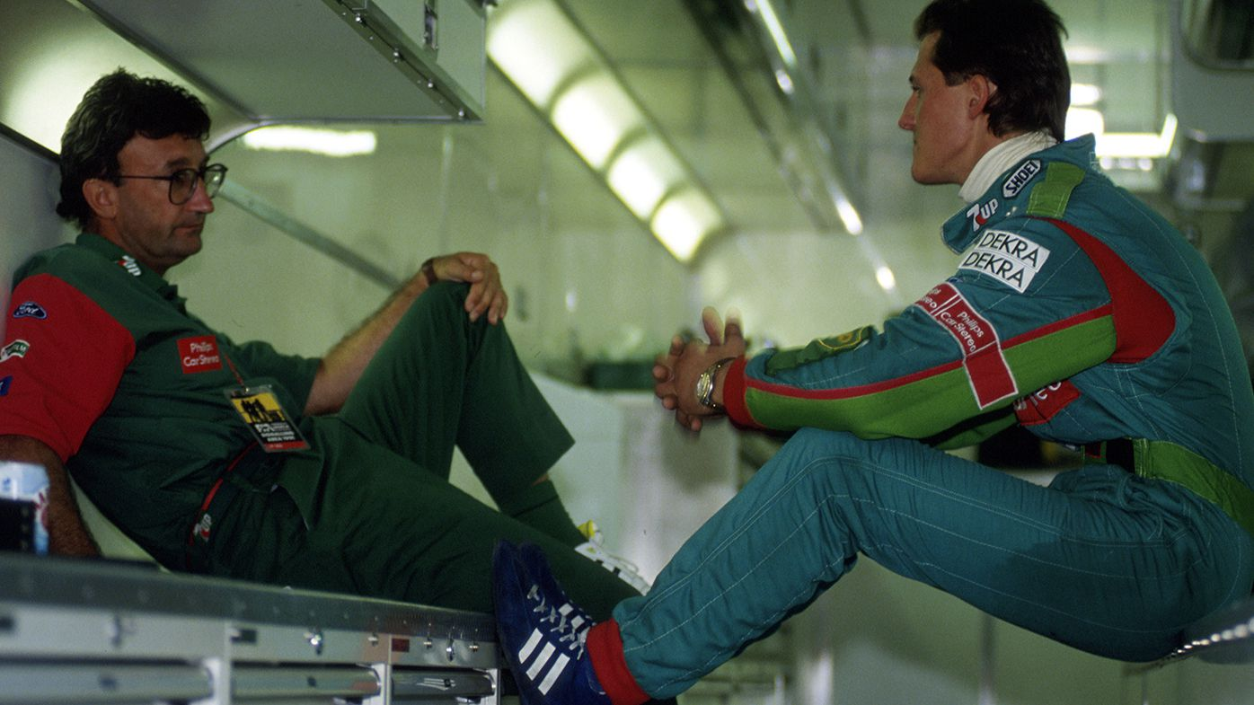 Team boss Eddie Jordan talks to Michael Schumacher at the 1991 Belgian Grand Prix.