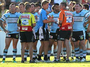 Sharks players gather after a Bulldogs try. (Getty)