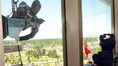 """Children at a Colorado hospital were thrilled when they looked out the window and saw their favourite superheroes rappelling past. <br><br> Members of the Aurora Police Department's SWAT team dressed up as Superman, Spiderman, Captain America, Batman, Robin and Wolverine and climbed down the wall of the Children's Hospital in the city of Aurora last week.  It was the second year in a row that the police department had teamed up with the hospital for the special display.<br><br>  Last year they did it to fulfil a request on a patient's bucket list, but now the police department wants to make it an annual event. <br><br> """"Our guys absolutely loved it. It's a different use of their skills, and putting smiles on those kids faces meant a lot to them,"""" Diana Cooley from Aurora police told NBC News. <br><br><b> Take a look through the gallery for the heartwarming photos shared by the Aurora Police Department and Children's Hospital Colorado. </b>"""