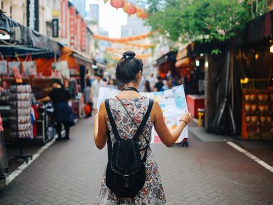 Young woman travelling in Singapore
