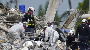 Storm threat hangs over renewed search at Florida condo site