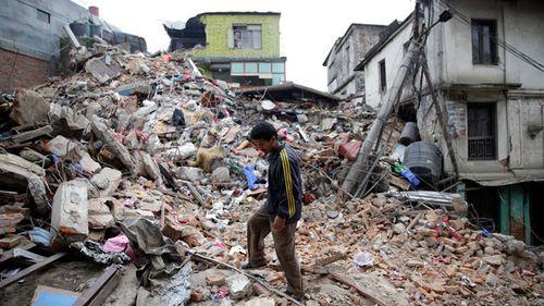 A man surveys the rubble of damaged building in Kathmandu. (AAP)