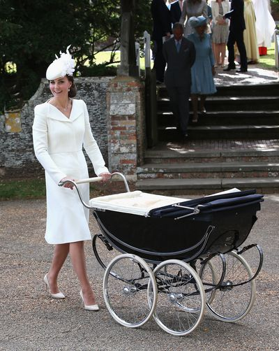 Kate Middleton rocked this stunning white button down at three different events over the course of three years. Here, she wears the tailored suit dress to the christening of her daughter Charlotte back in 2015.
