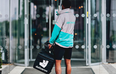 Deliveroo driver dropping off order
