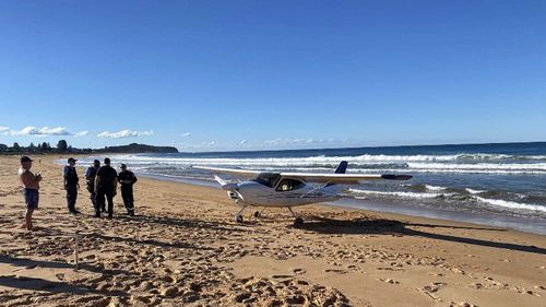 A light plane has landed on the sand at Collaroy Beach.