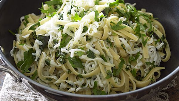 Wok-tossed tagliatelle squid with fresh herbs and lemon