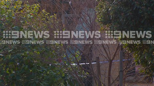 The officers smashed through a window and helped a man out of the burning building. Picture: 9NEWS