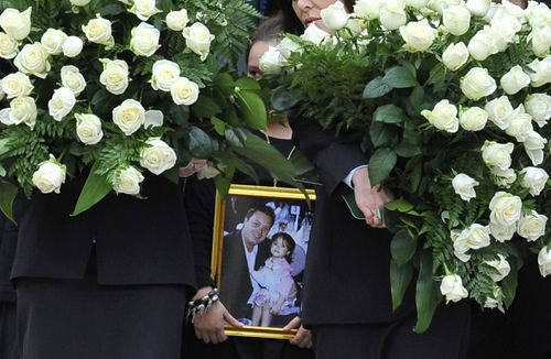 Dhakota pctured as a younh child with her father Carl Williams, at his funeral in 2010. (AAP)