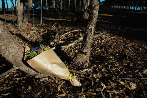 Flowers were left near the property for the family.