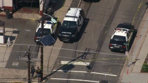 Initial reports suggested the man was armed with a knife. (9NEWS)