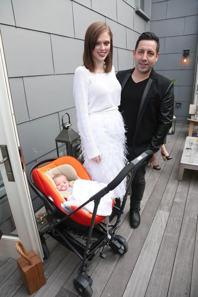 <p>Model child: Coco Rocha, in New York with husband James Conran, and their newborn daughter tucked into a classic Cybex.</p>