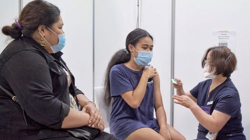 A young woman gets vaccinated in Dandenong, Melbourne.