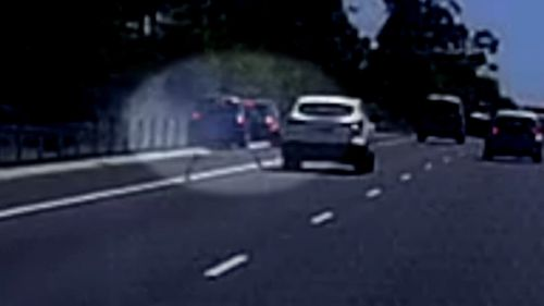 Another driver's dashcam caught the heart-stopping moment a highway officer was rammed into on the NSW Mid North Coast.